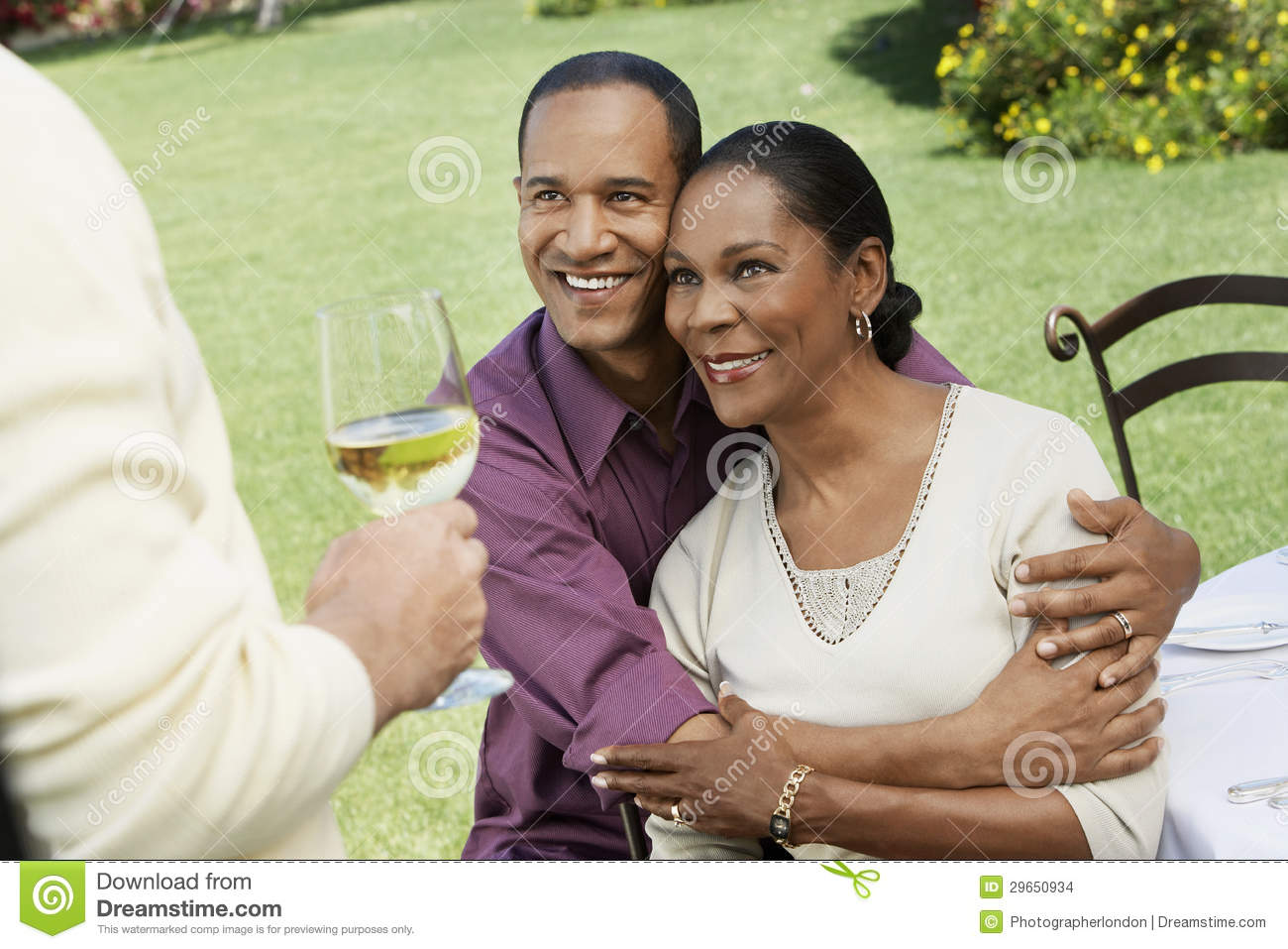 Couple Embracing In Front Of Friend