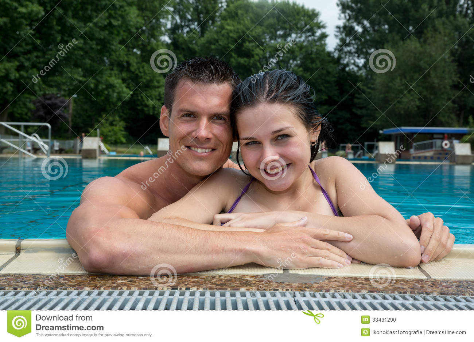 Couple Enjoying Holidays At Pool Edge Stock Photo Image 33431290