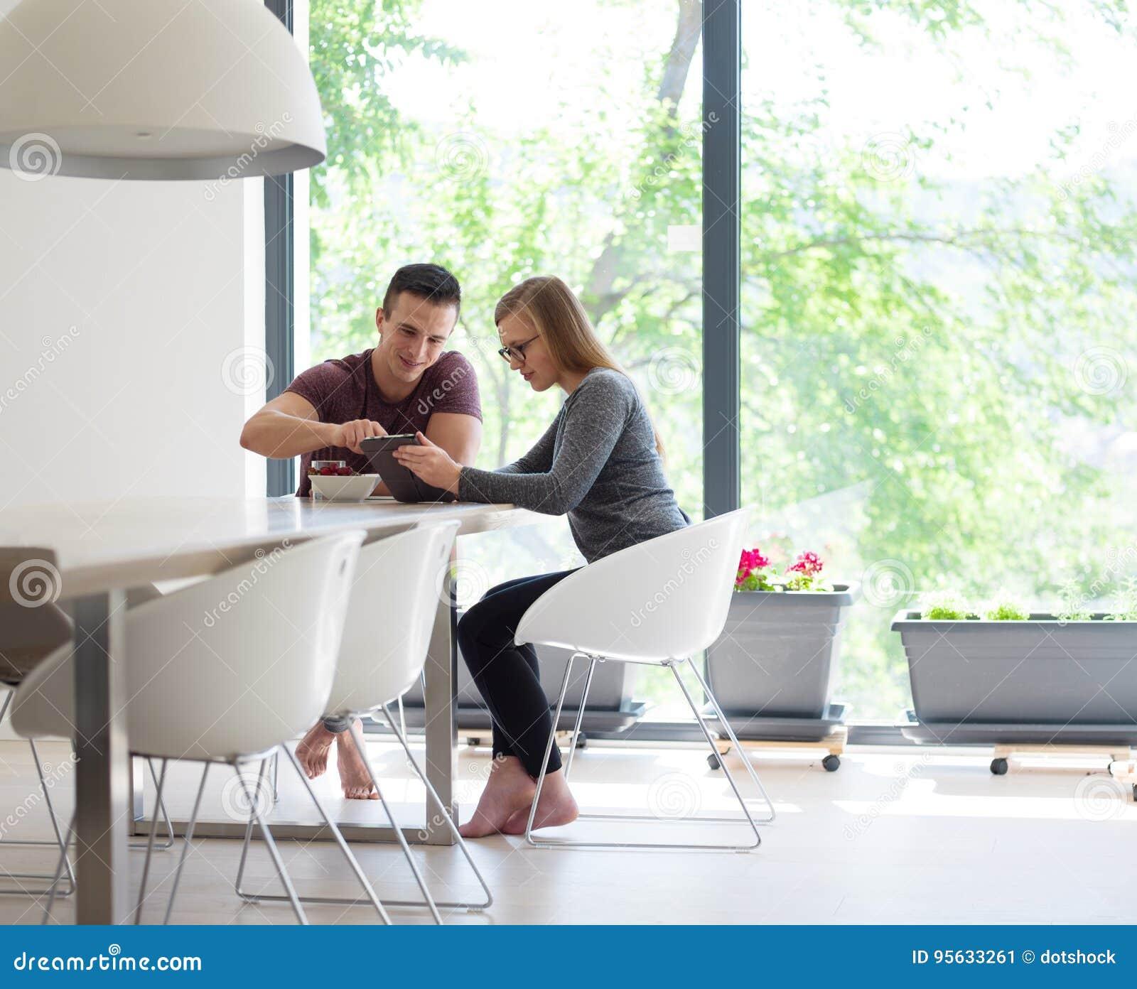 Couple Enjoying Their Summer Holidays Stock Photo: Couple Enjoying Morning Coffee And Strawberries Stock