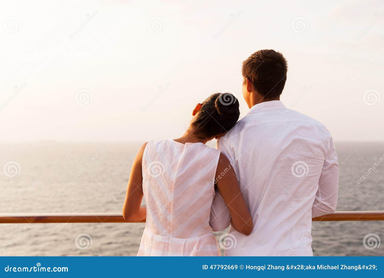 Couple enjoying sunset cruise