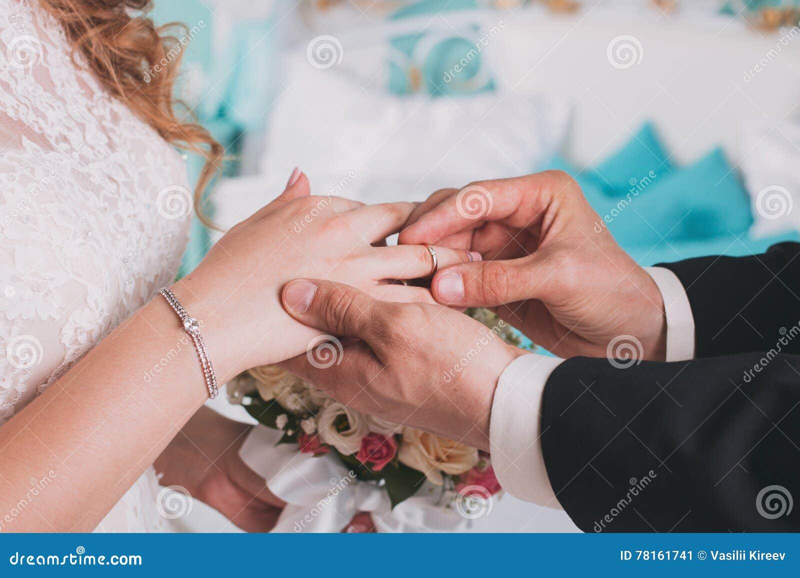 The Couple Exchange Wedding Rings Stock Image ...