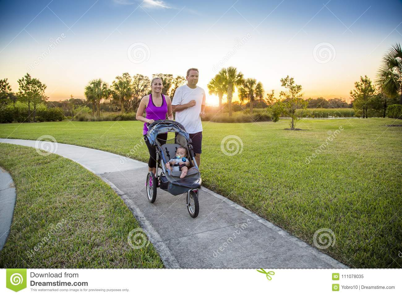 Couple exercising and jogging together at the park