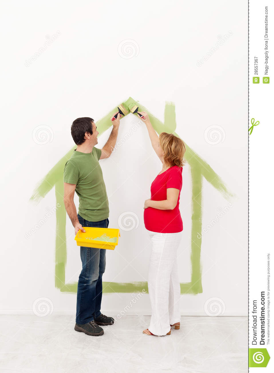 Couple Expecting A Baby Painting Their Home Stock Image