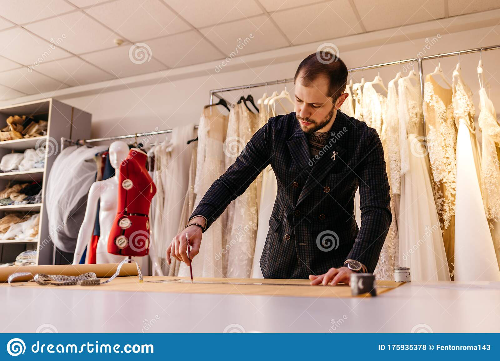 Couple Of Fashion Designers Working With Fabric And Clothing Sketches At The Studio Full Of Tailoring Tools And Equipment Stock Photo Image Of Cloth Fashionable 175935378