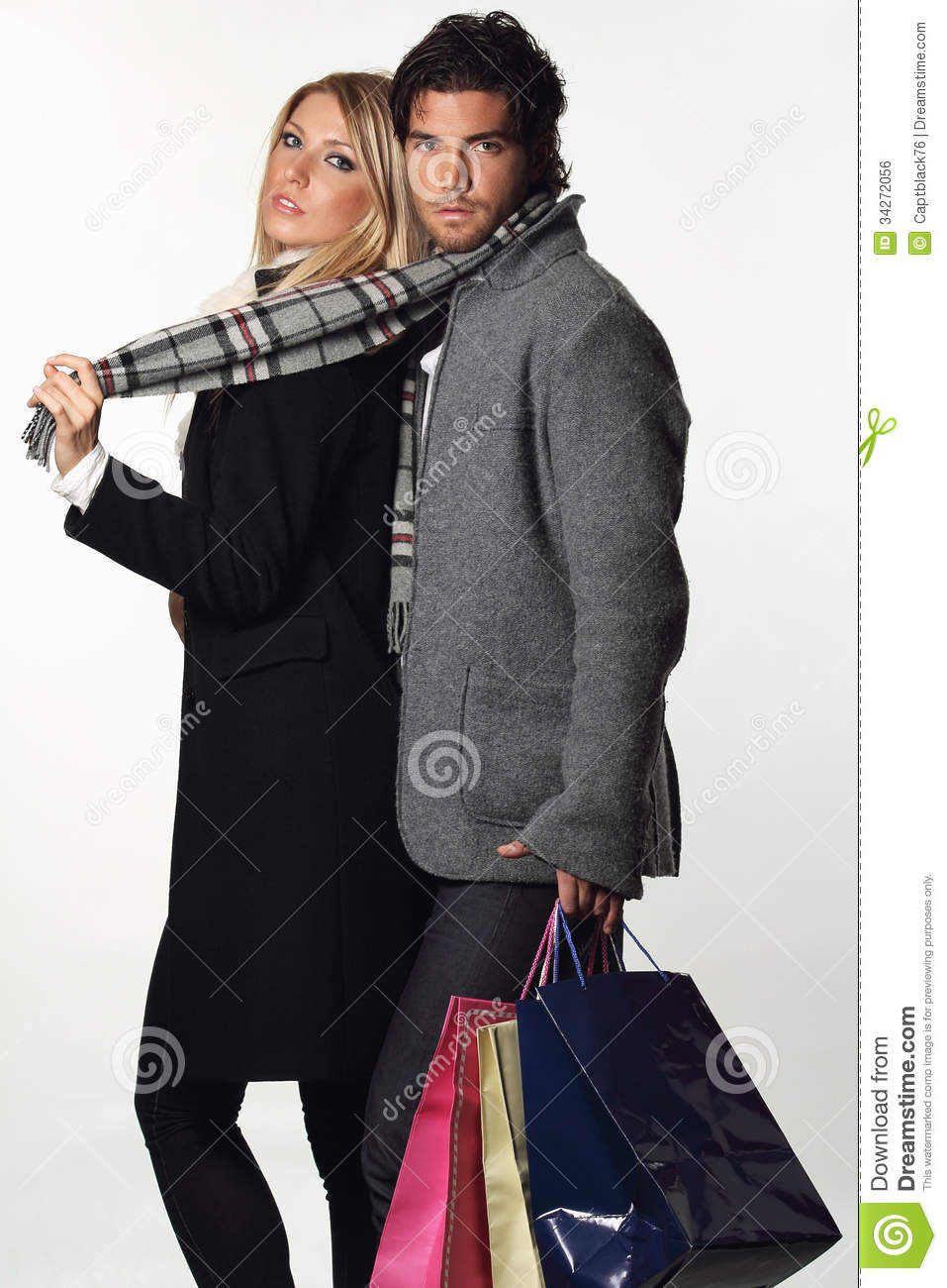 Couple Of Fashion Models Wearing Winter Dress Royalty Free ...