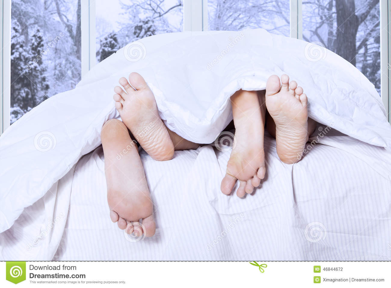 Couple feet sleeping on bed stock photo image 46844672 for Sleeping with window open in winter