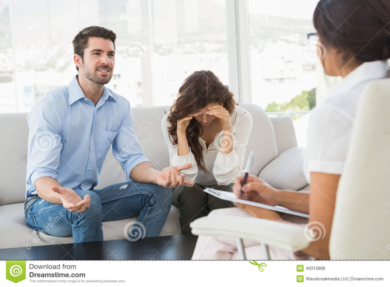 Couple Fighting Together In Front Of Their Therapist Stock Photo