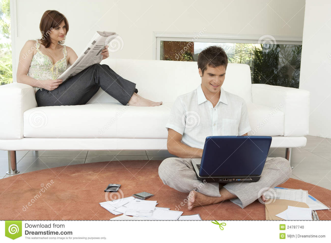 Couple Finances On Couch Stock Photo Image 24787740