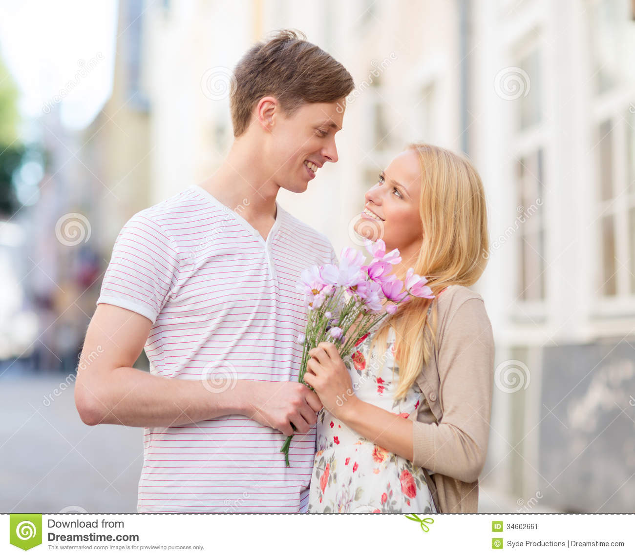 Couple Enjoying Their Summer Holidays Stock Photo: Couple With Flowers In The City Stock Image