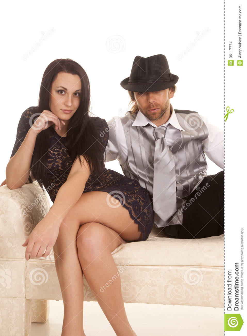 Couple In Formal Attire On Couch She Look Stock Images -2922