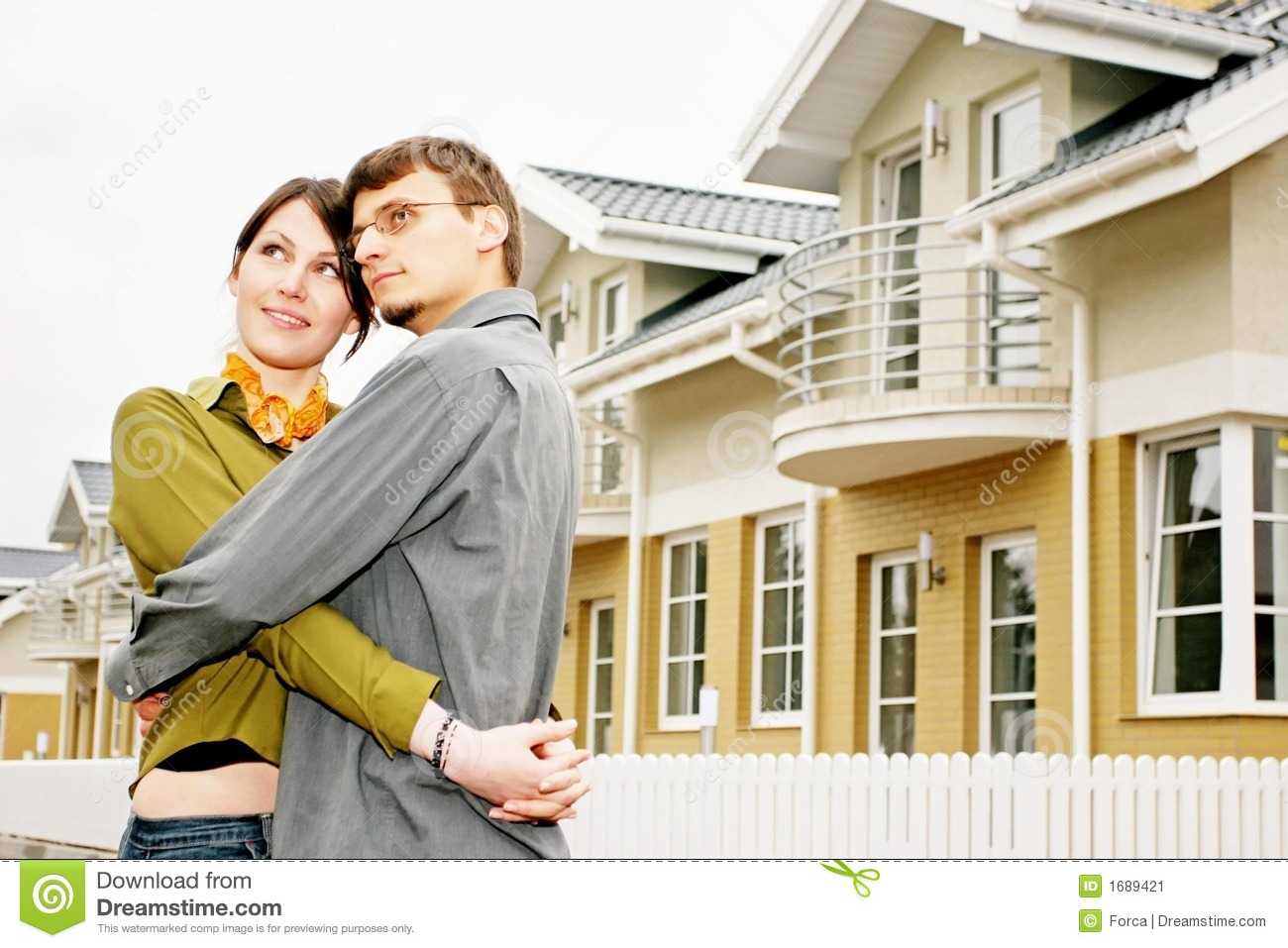 Couple in front of family house