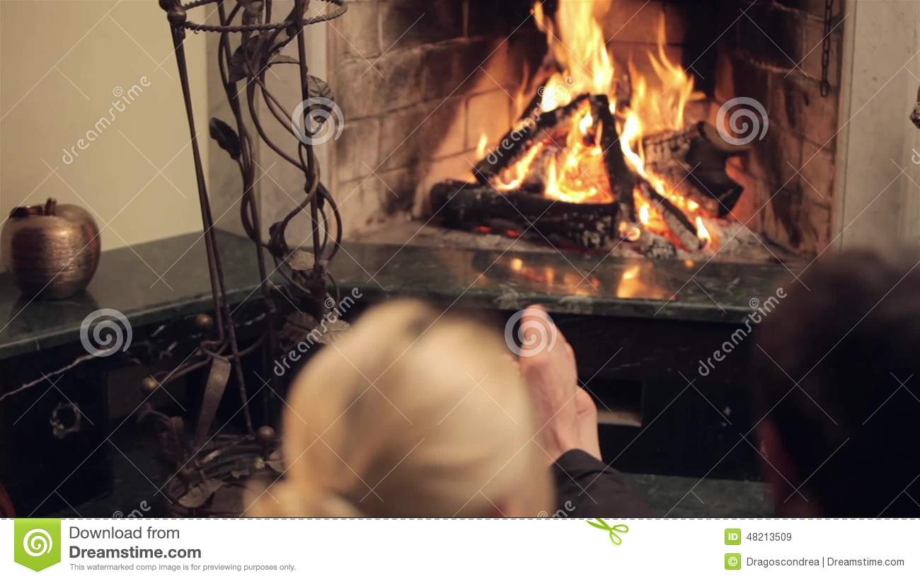 couple in front of a fireplace stock video video 48213723