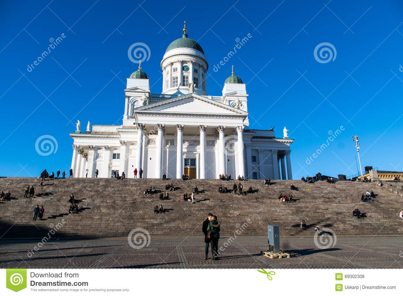 A couple in front of Helsinki Cathedral, Finland