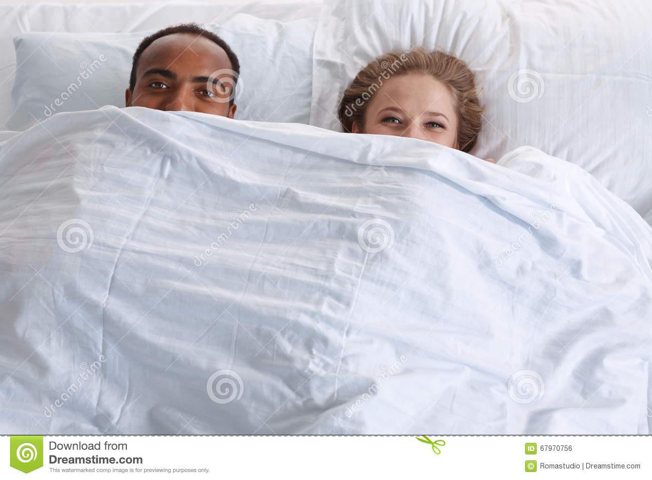 Couple With Funny Faces Under The Sheet Stock Photo Image