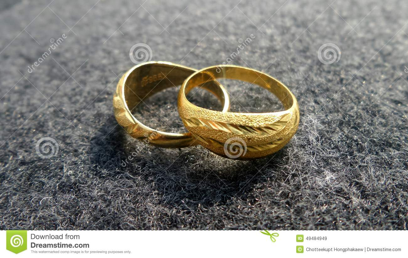 Couple Golden Rings On Synthetic Fiber Fabric Stock Image Image Of