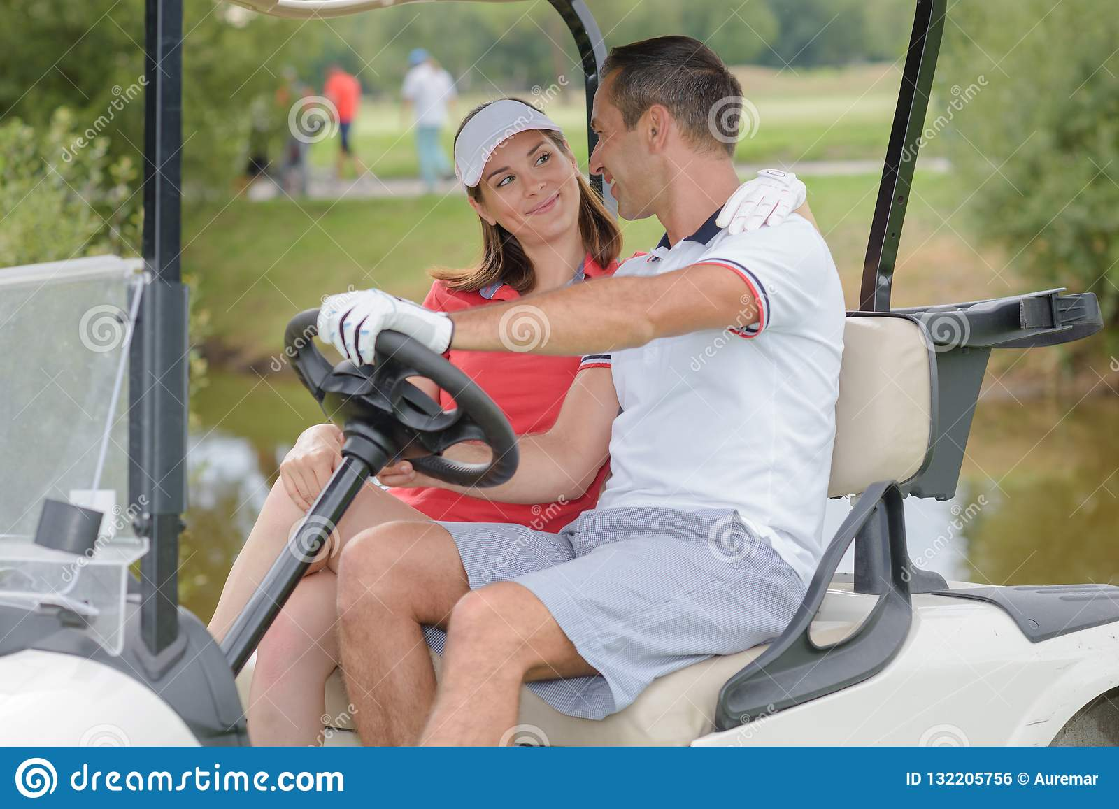Couple on golf buggy