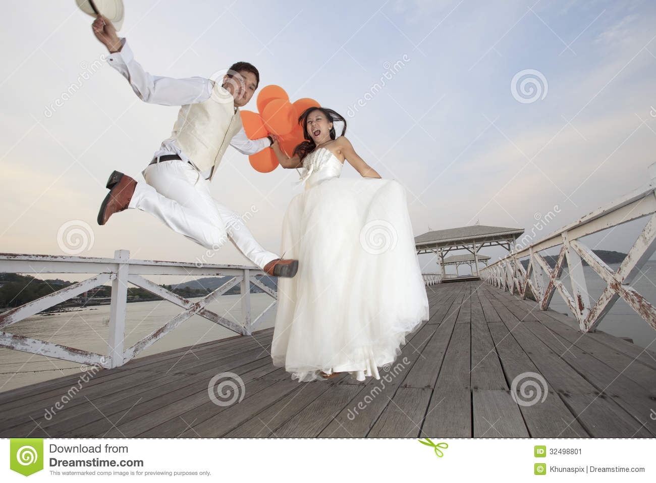 Couple Of Groom And Bride In Wedding Suit Jumping With Glad Em Stock ...