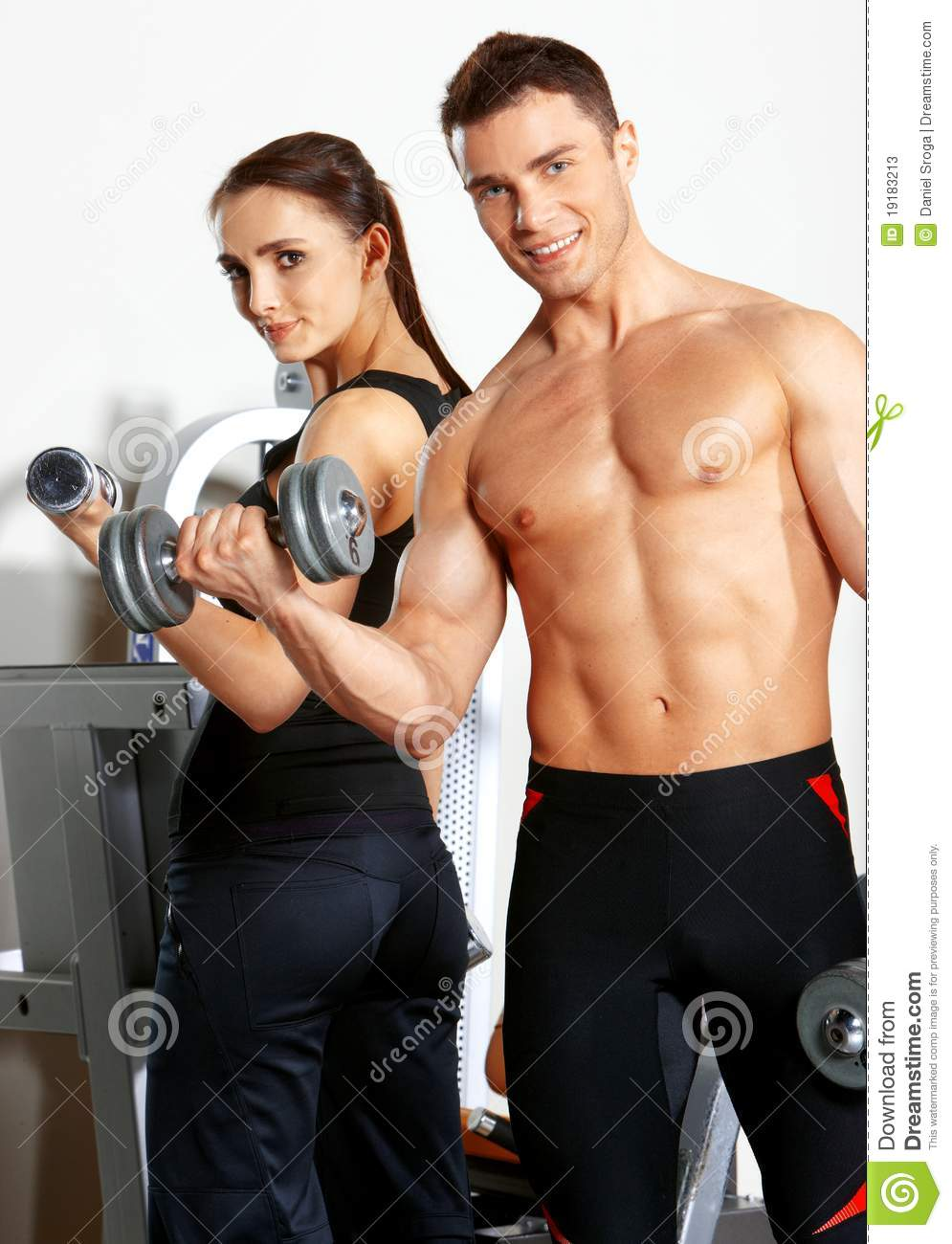 Couple at the gym stock image. Image of active, fitness
