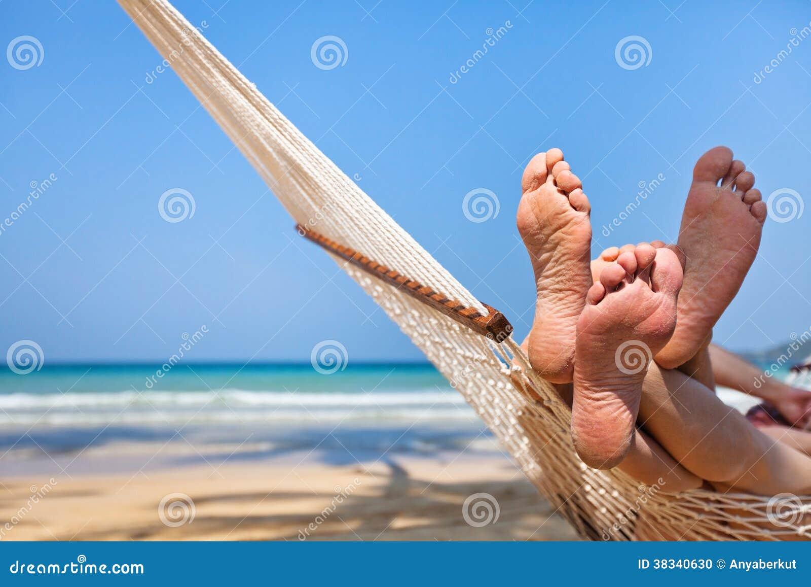 nude sleeping in a hammock