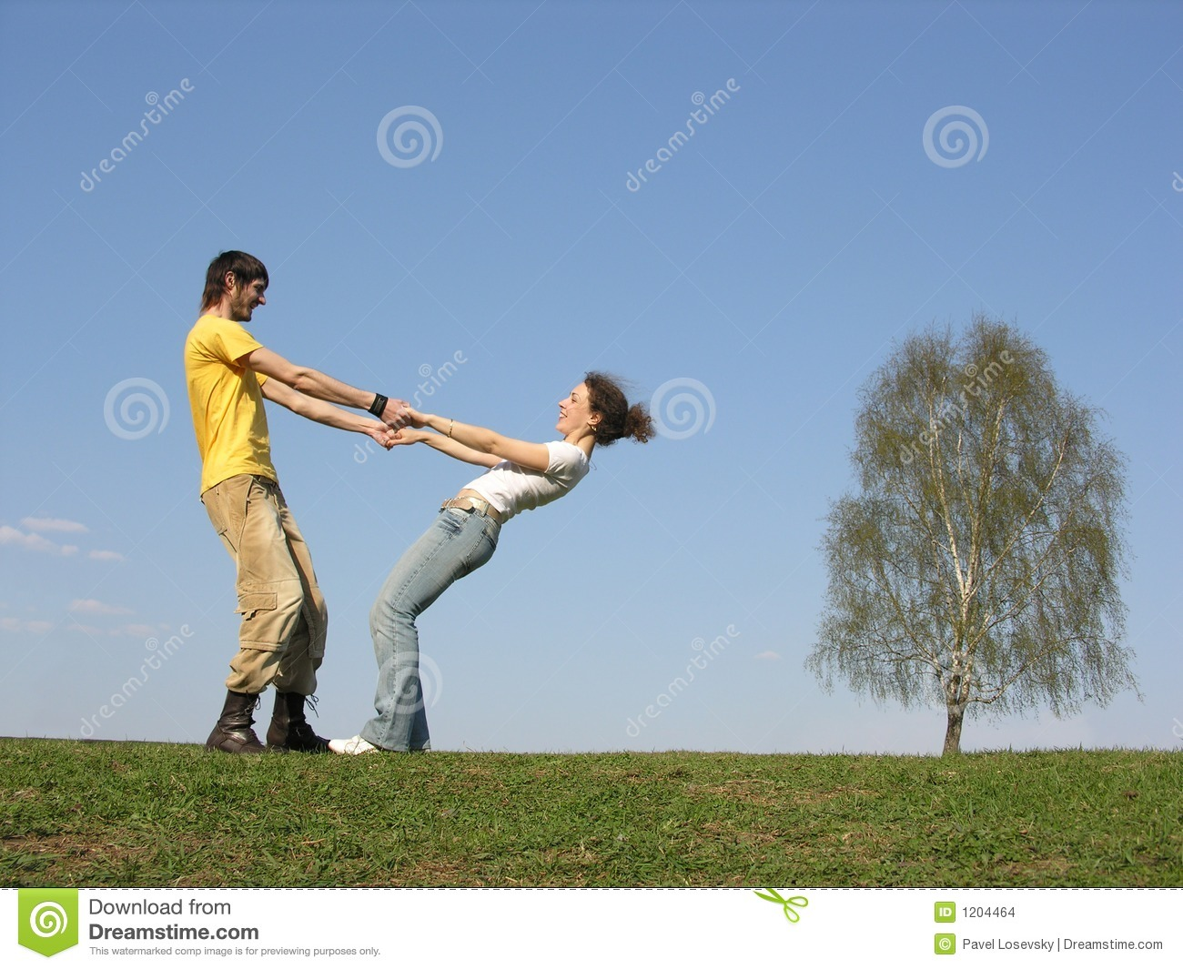 Couple with hands on grass