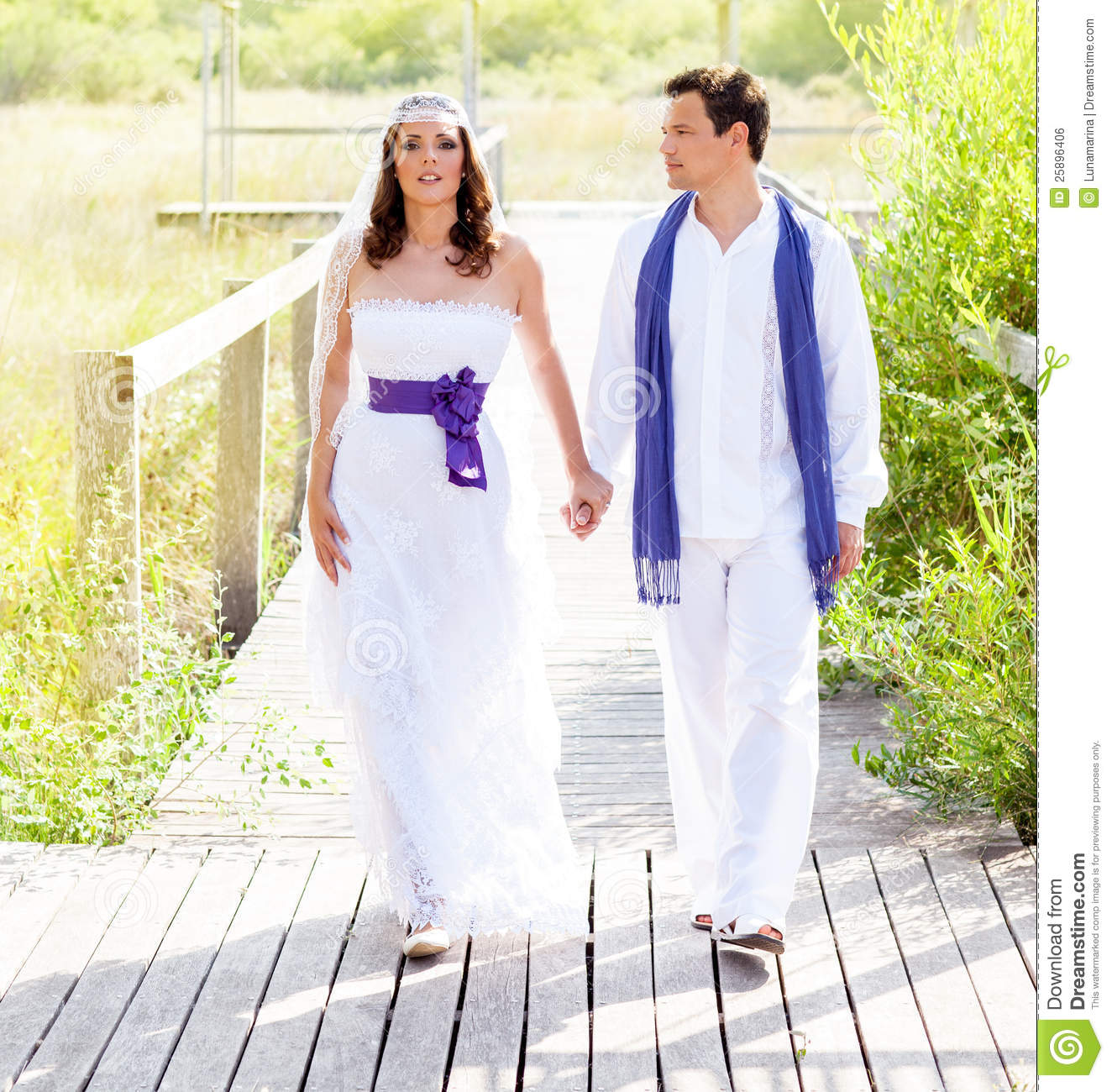 Couple Happy In Wedding Day Walking Outdoor Royalty Free