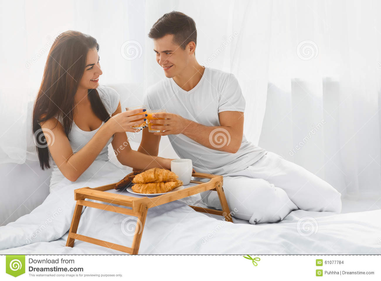 Good Morning Love Bed : Couple having breakfast in bed stock photo image