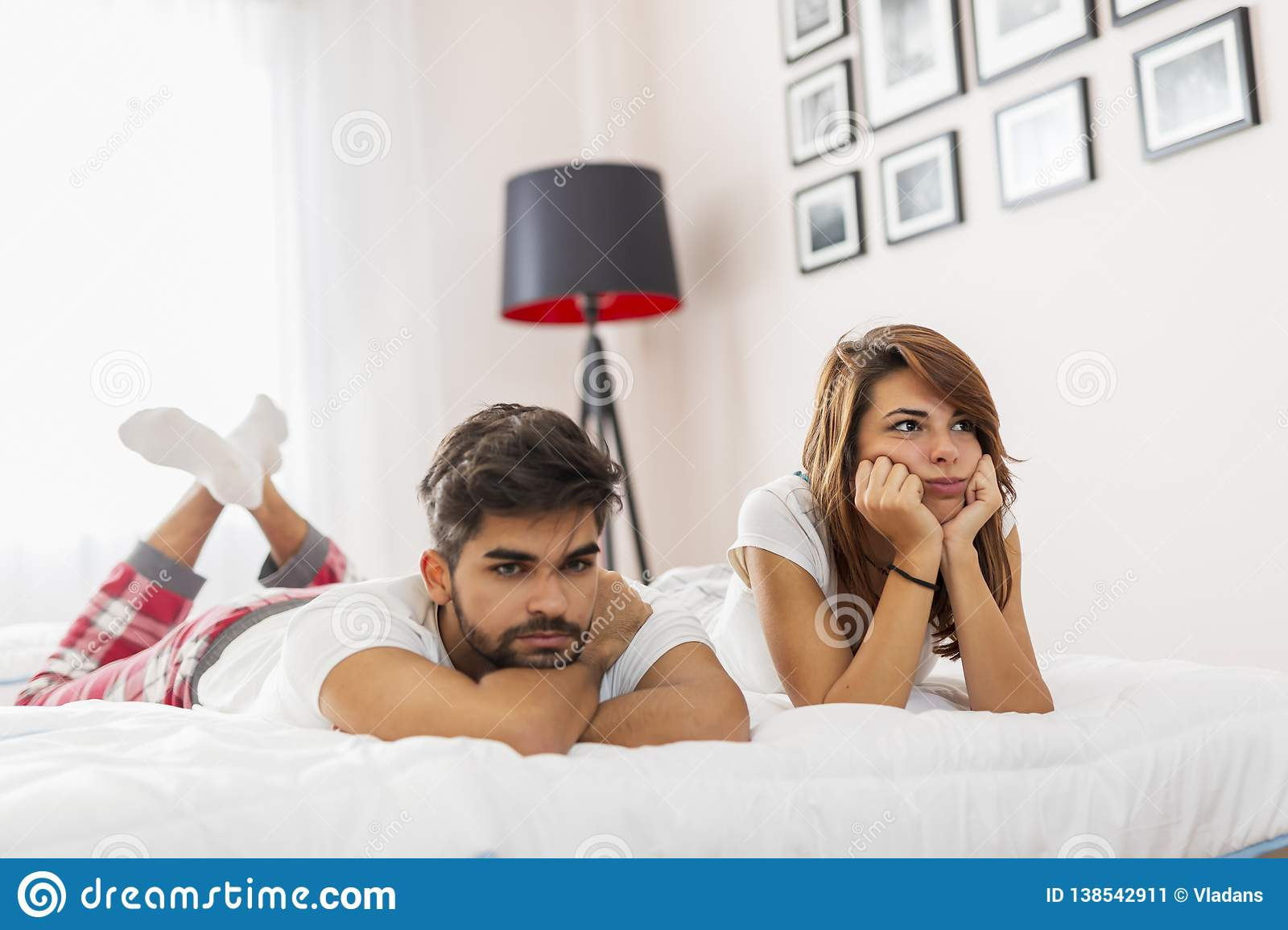 Couple having a fight in bedroom