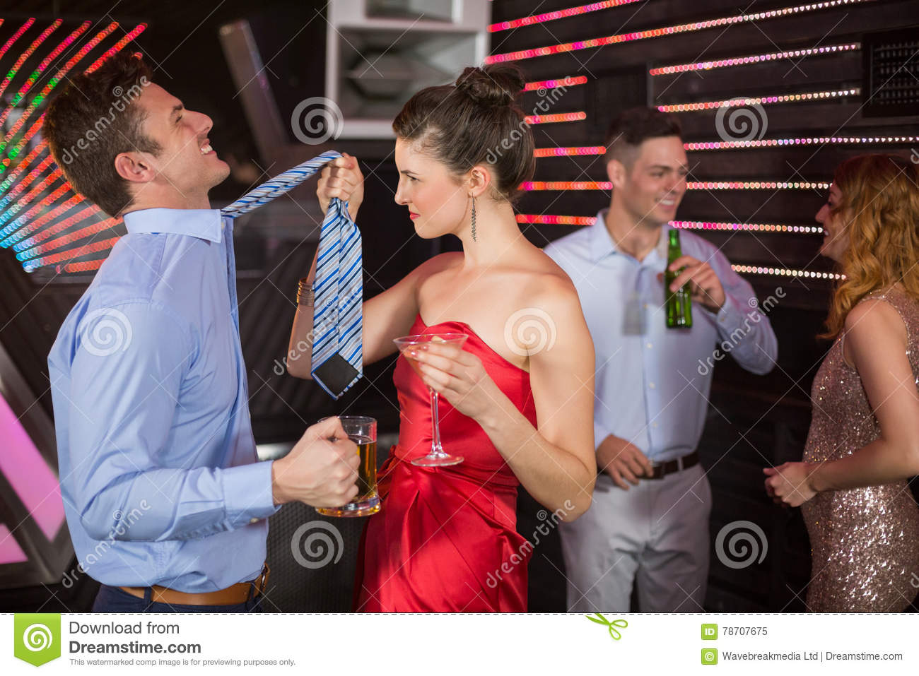 Couple having fun while having glass of beer and cocktail