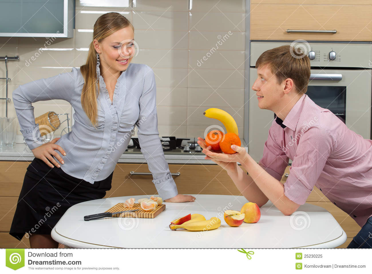 Fun Kitchen Couple Having Fun On A Kitchen Royalty Free Stock Photo Image