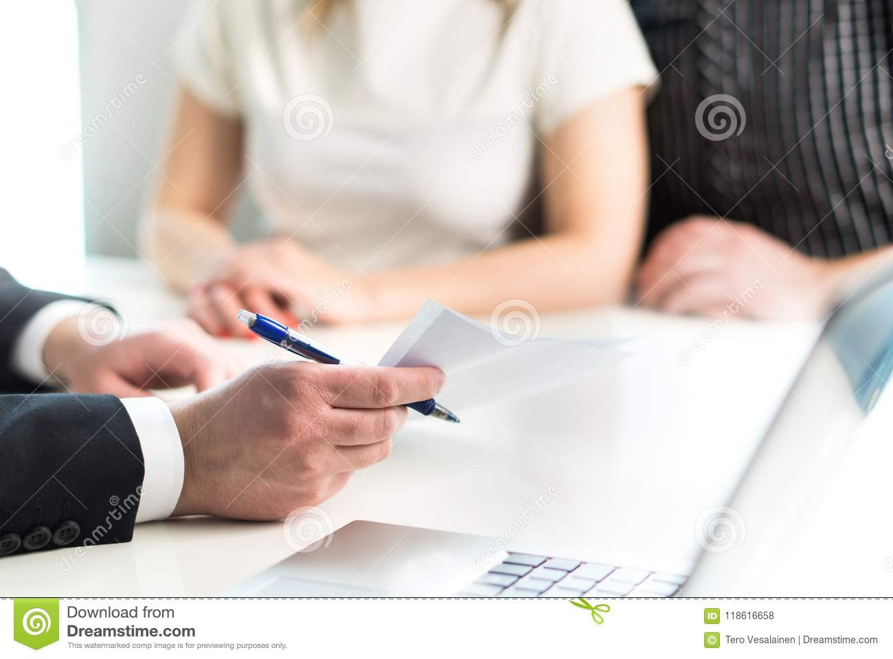 Couple having meeting with legal advisor, real estate agent.