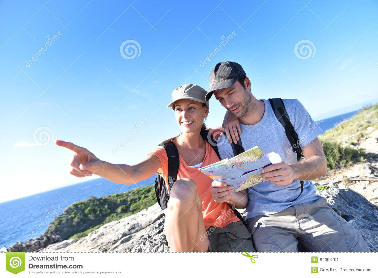 Couple of hikers admiring view on islands