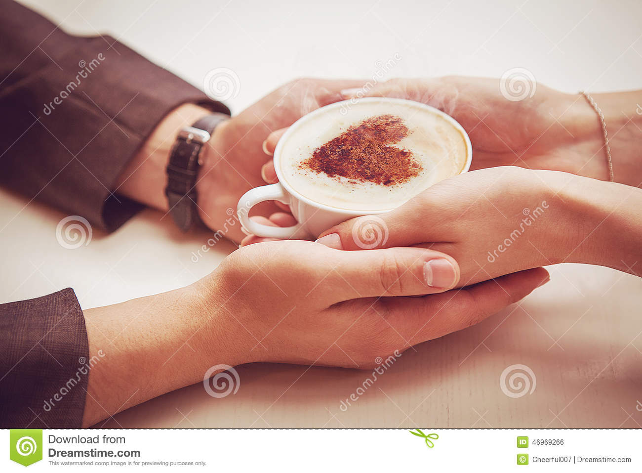 Couple Holding A Cup With Heart Stock Photo Image 46969266