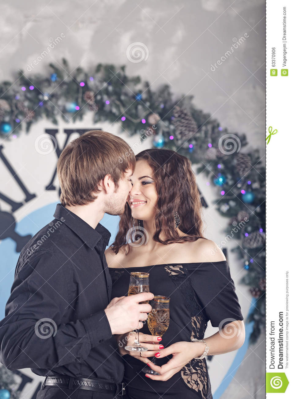 Couple Holding Glasses With Wine. Christmas. Kiss. Stock Photo ...