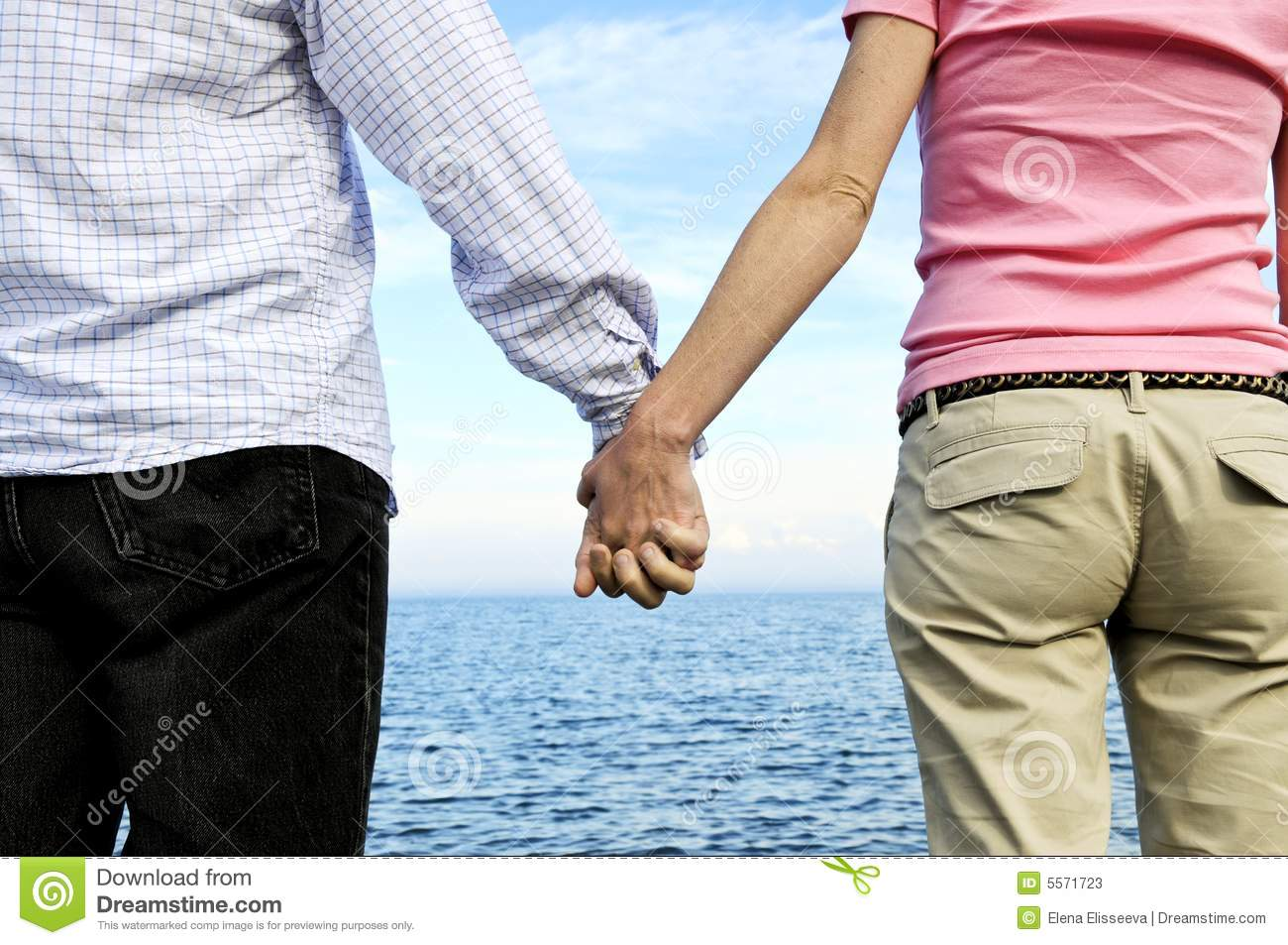 Couple Holding Hands Stock Photos - Image: 5571723