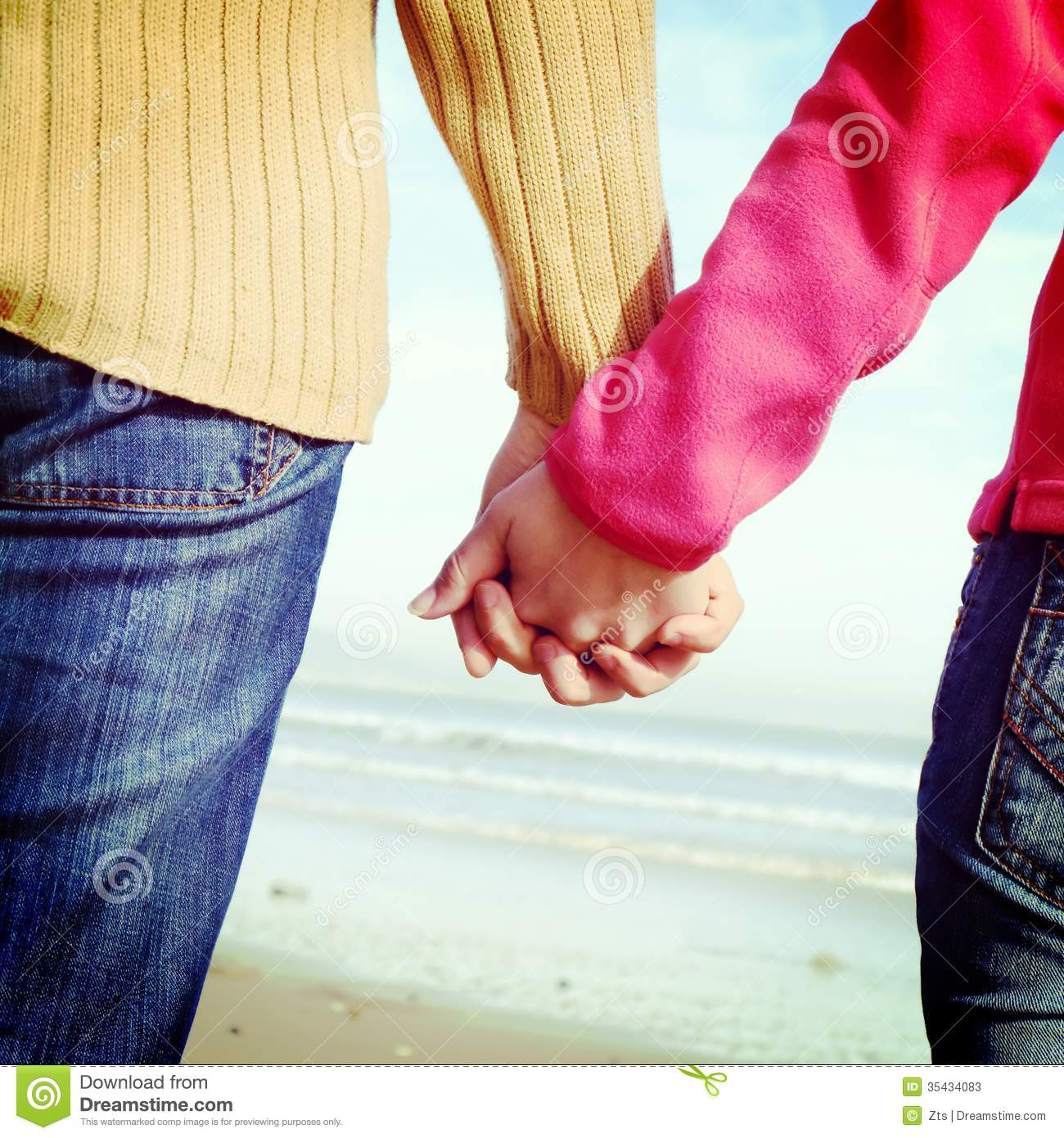 Couple Holding Hands In Beach Stock Photos - Image: 35434083