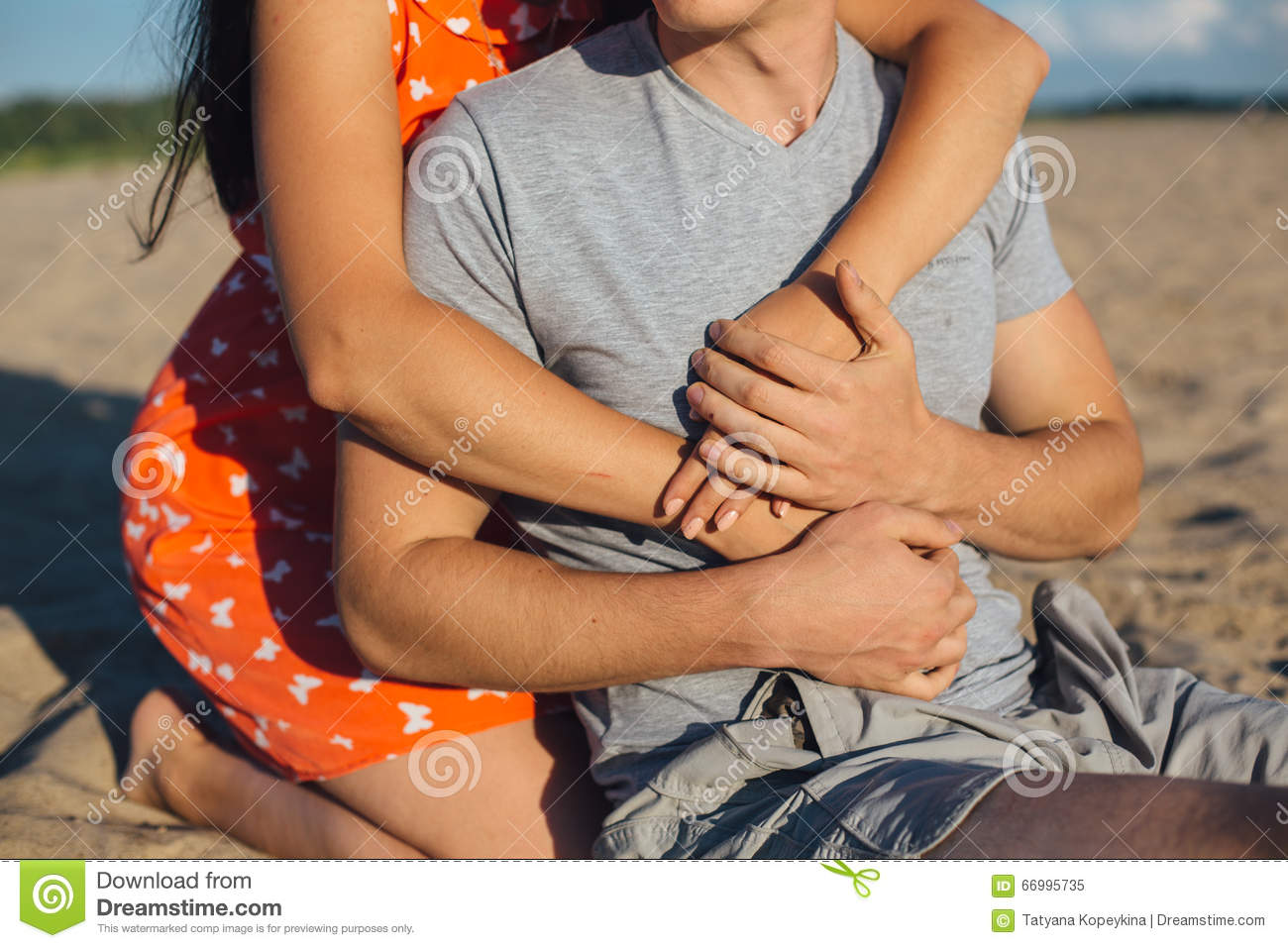 Couple holding hands in beach
