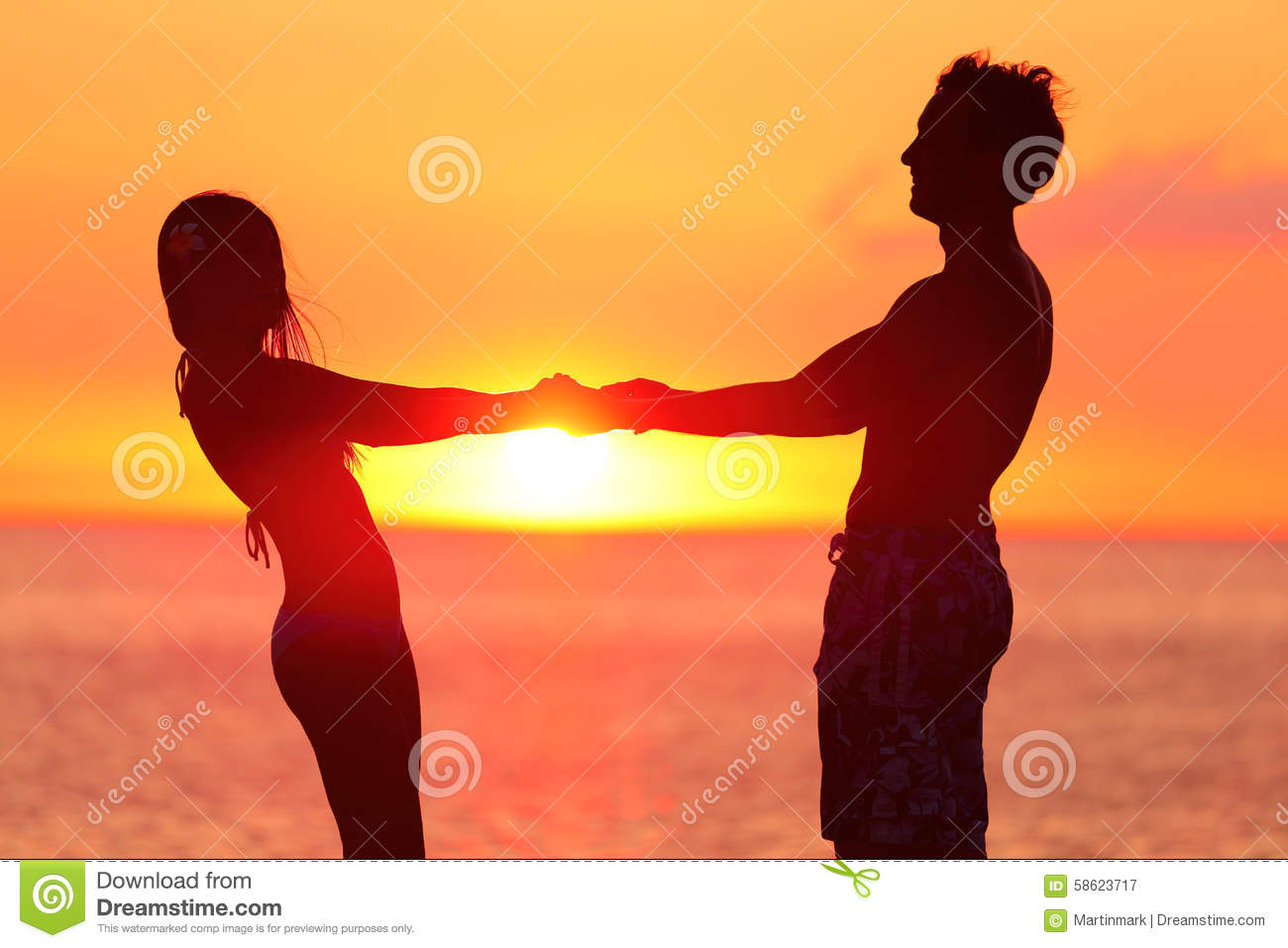 Couple Holding Hands At Beach During Sunset Stock Image - Image of ... for Couple Holding Hands Silhouette Sunset  56mzq
