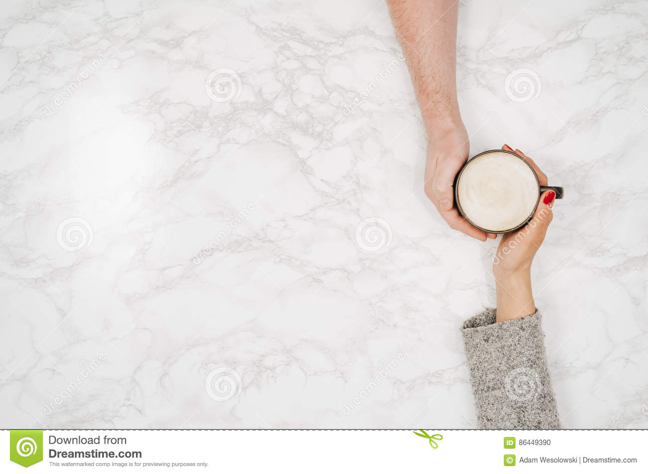White marble table tops - Couple Holding Hands With Coffee White Marble Table Top View Stock Photo