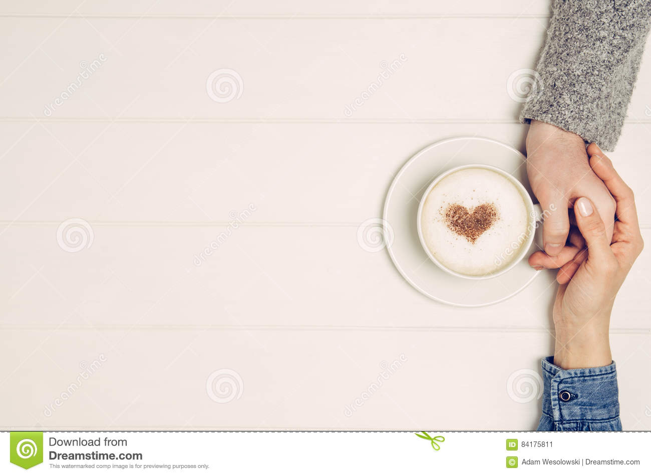 White table top view White Working Couple Holding Hands With Coffee On White Table Top View Dreamstimecom Couple Holding Hands With Coffee On White Table Top View Stock