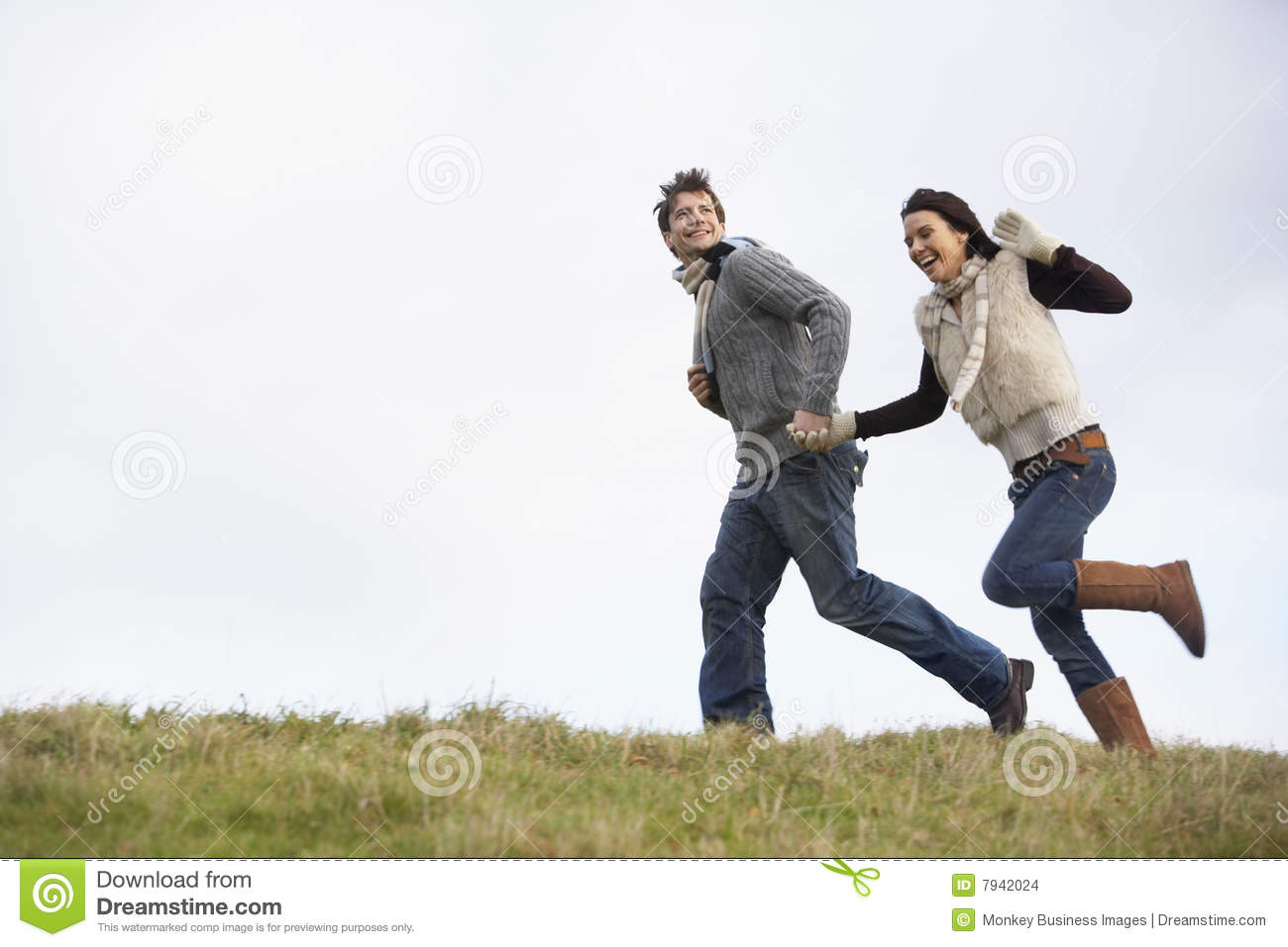 Couple running together holding hands