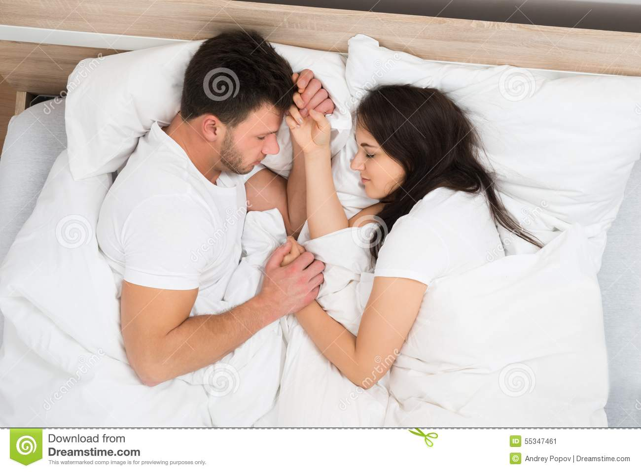 Couple Holding Hands Sleeping On Bed Stock Image Image