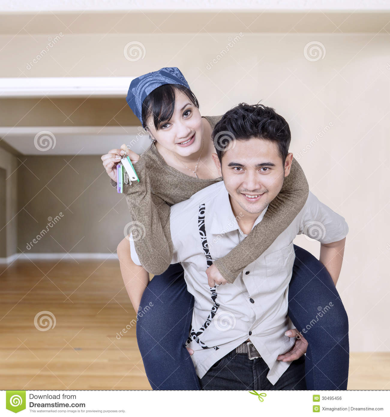 Couple Holding Keys Of New Home Stock Photo