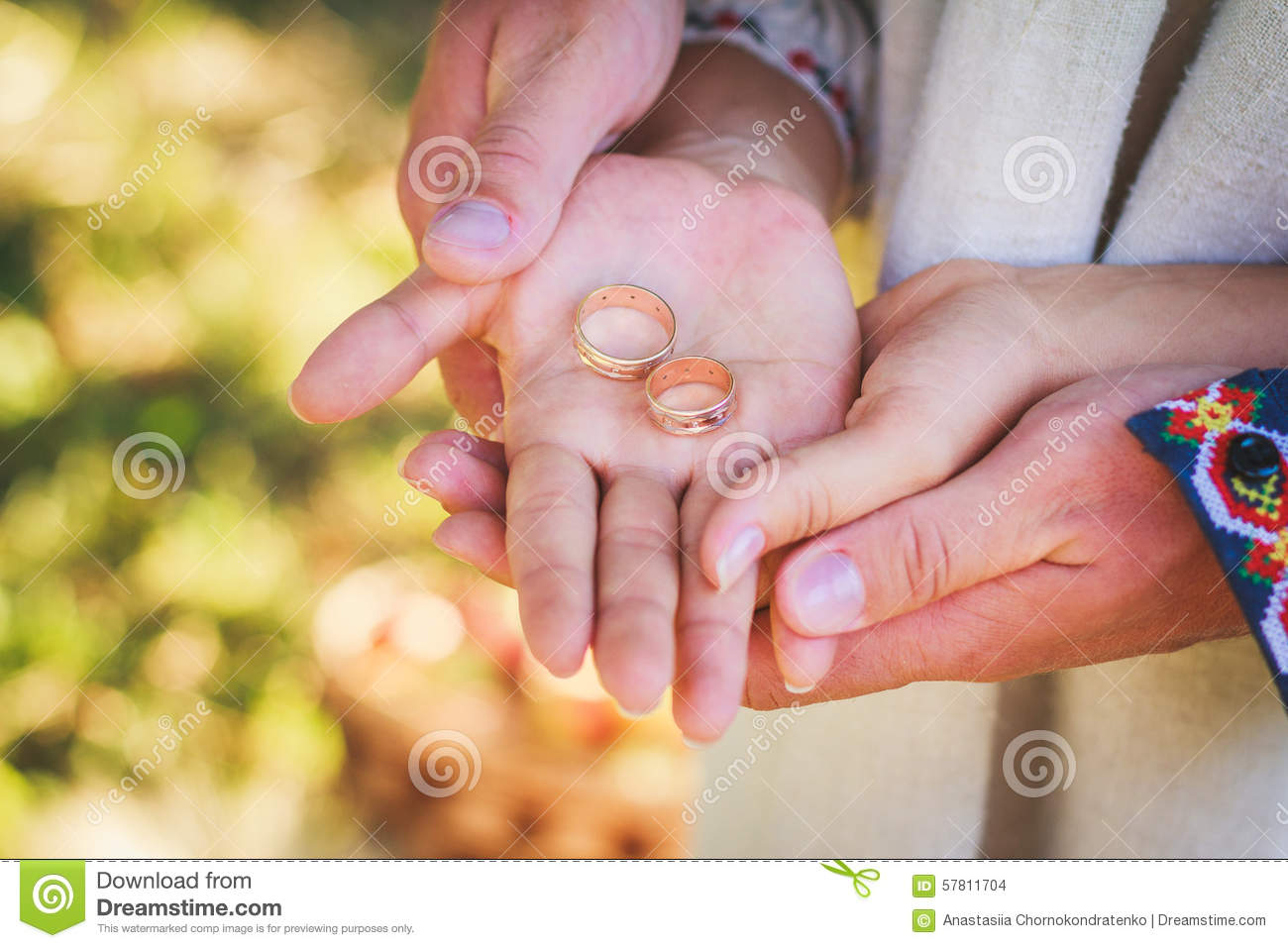 Couple Holding Wedding Rings In Their Hands Stock Photo - Image of ...
