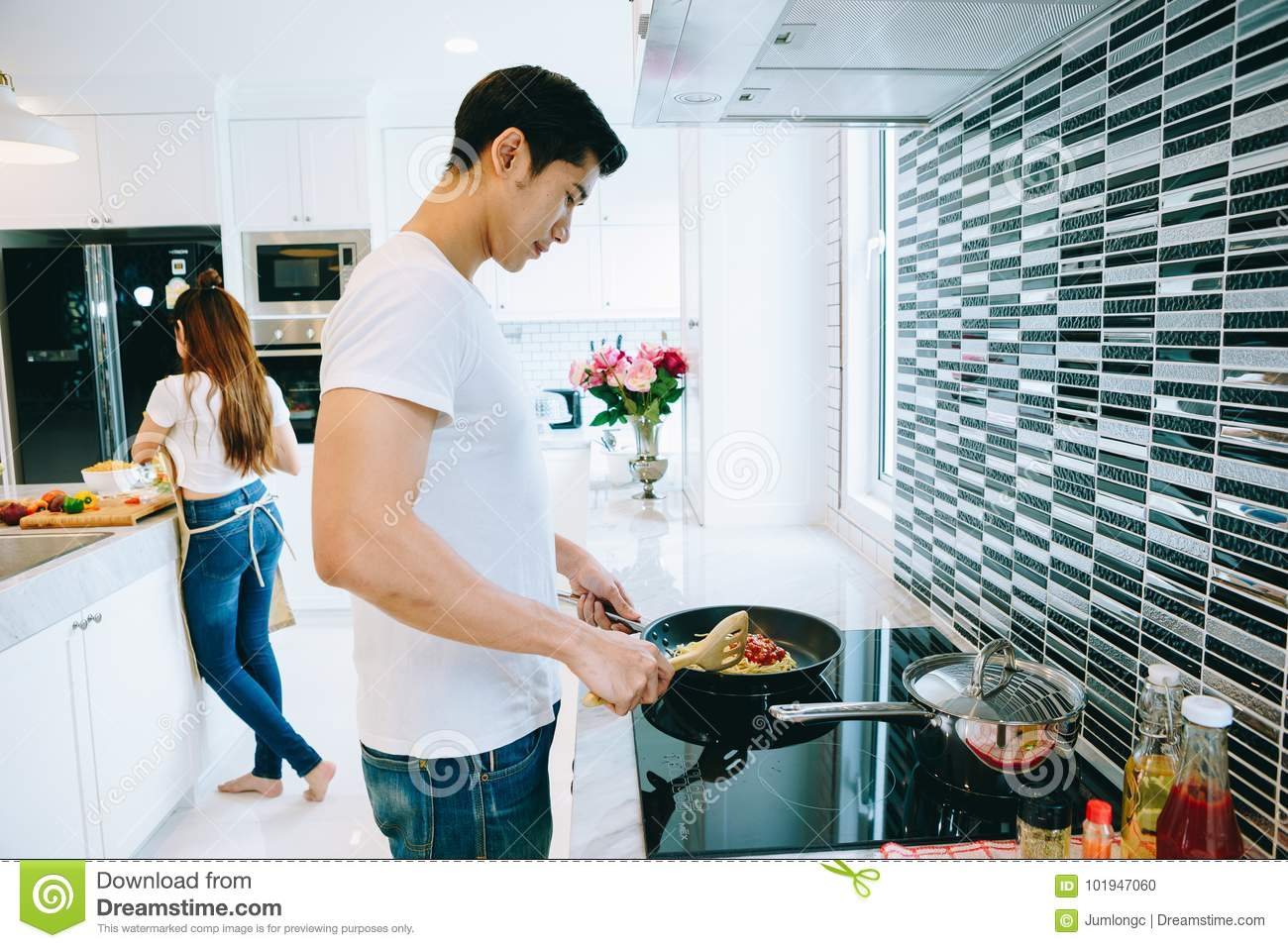 Couple in the house stock photo image of alcohol home for Valentine s day meals to cook together