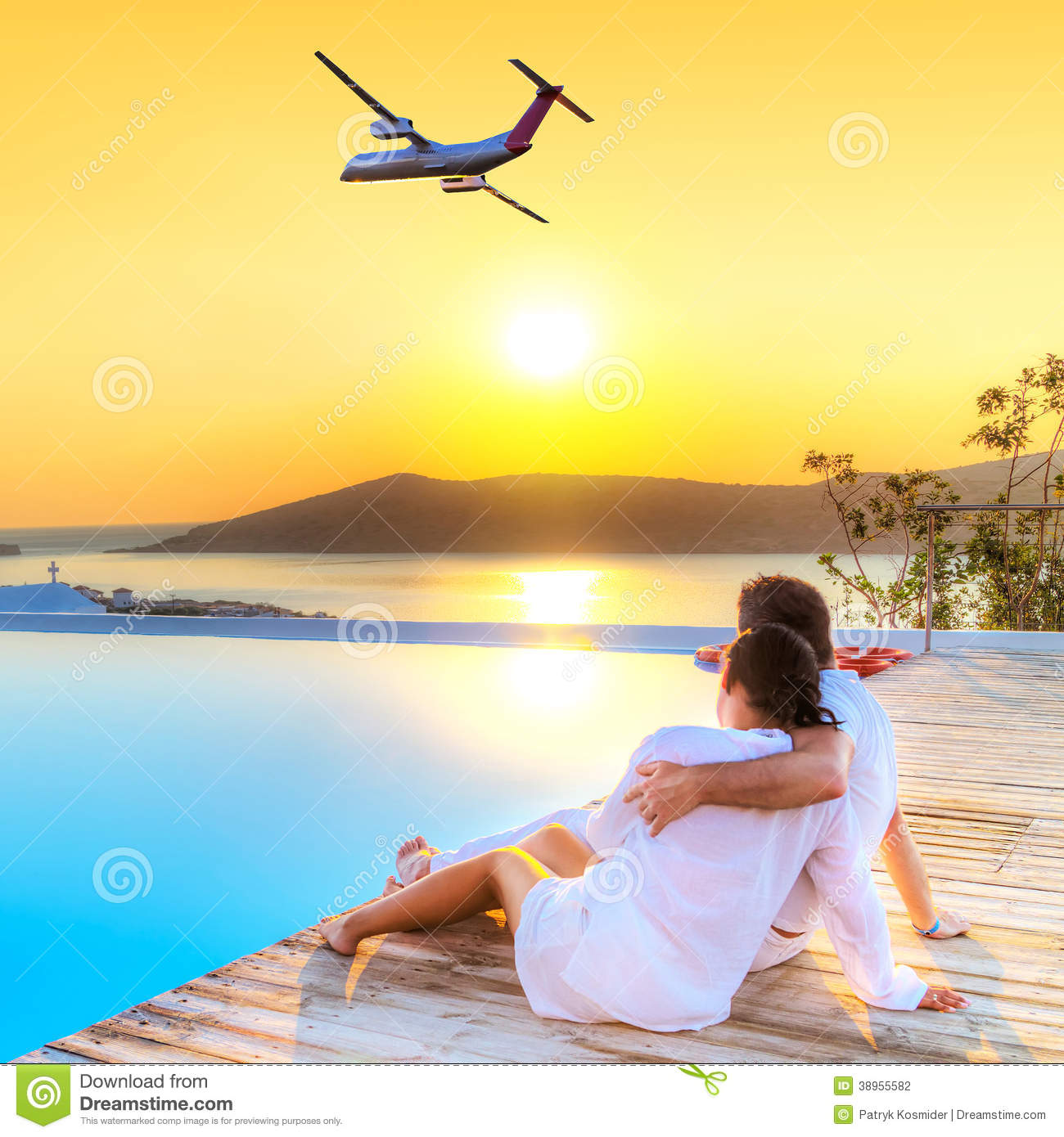 Couple In Hug Watching Airplane At Sunset Stock Photo