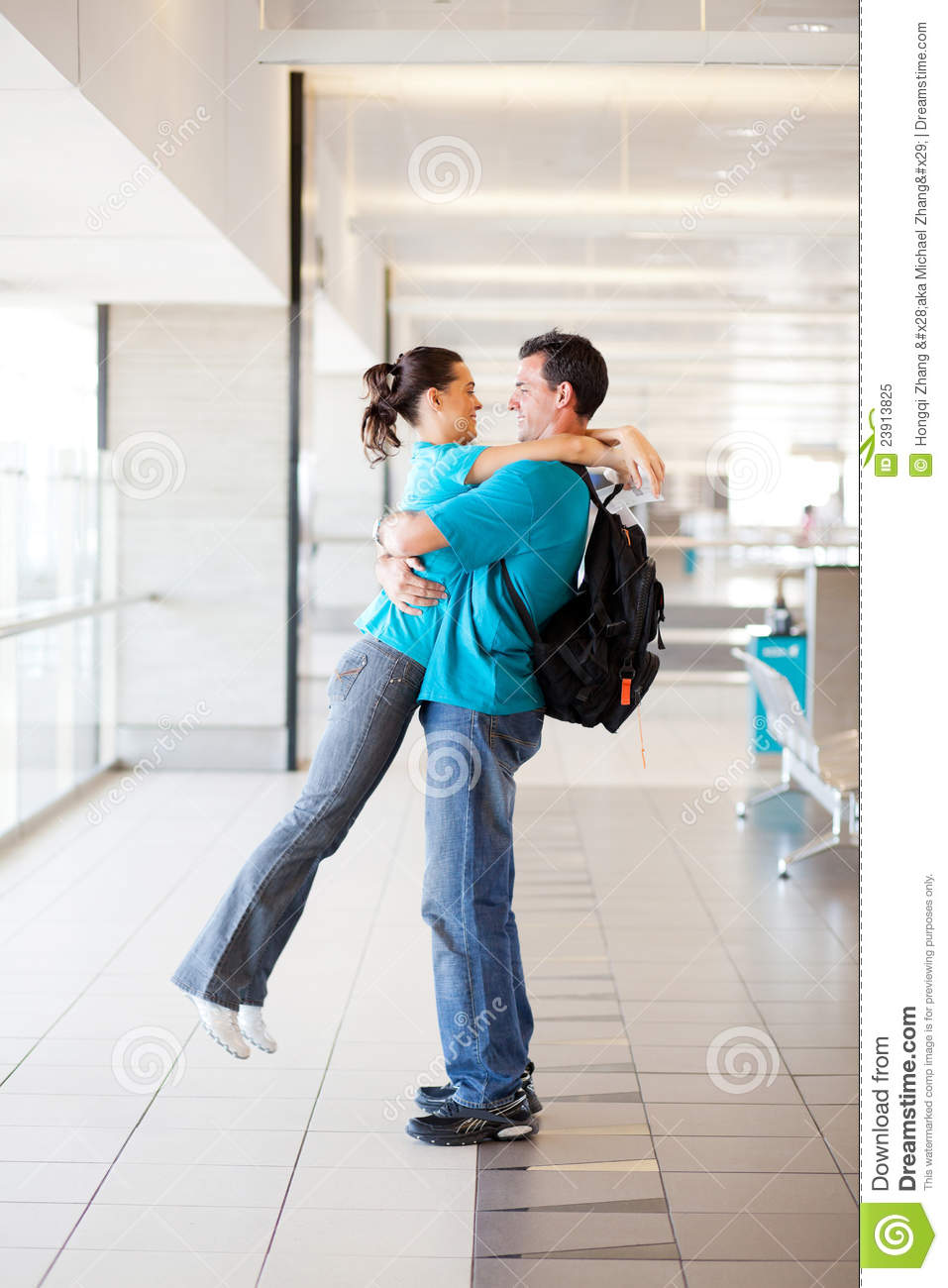 Couple Hugging At Airport Royalty Free Stock Photo - Image ...