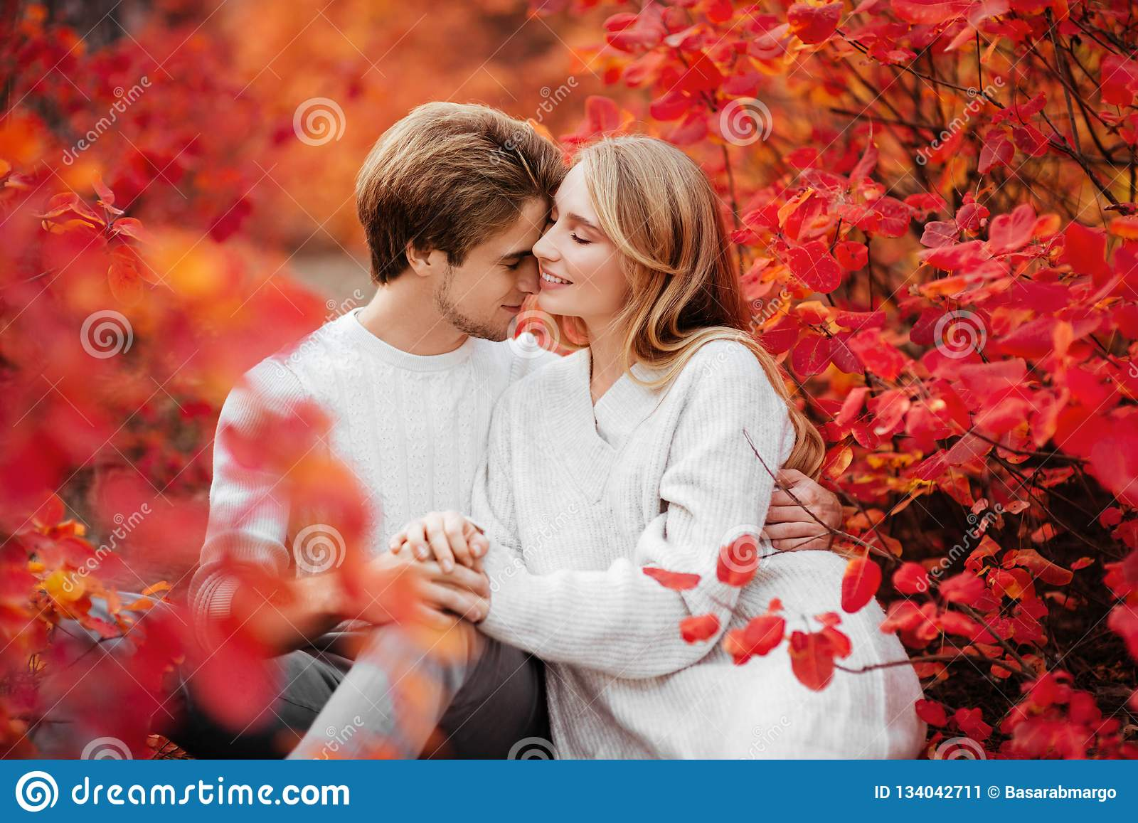Couple is hugging and sitting close