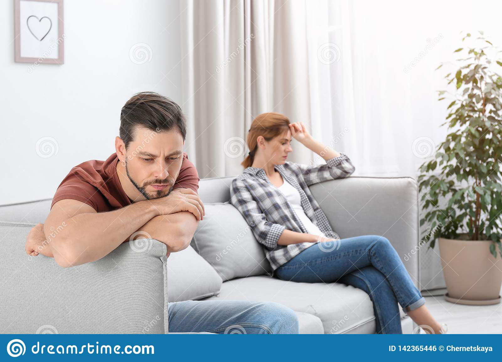 Couple Ignoring Each Other After Argument In Living Room
