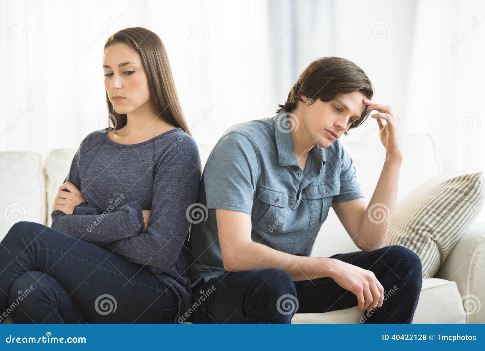 Couple Ignoring Each Other On Sofa Stock Photo - Image: 40422128