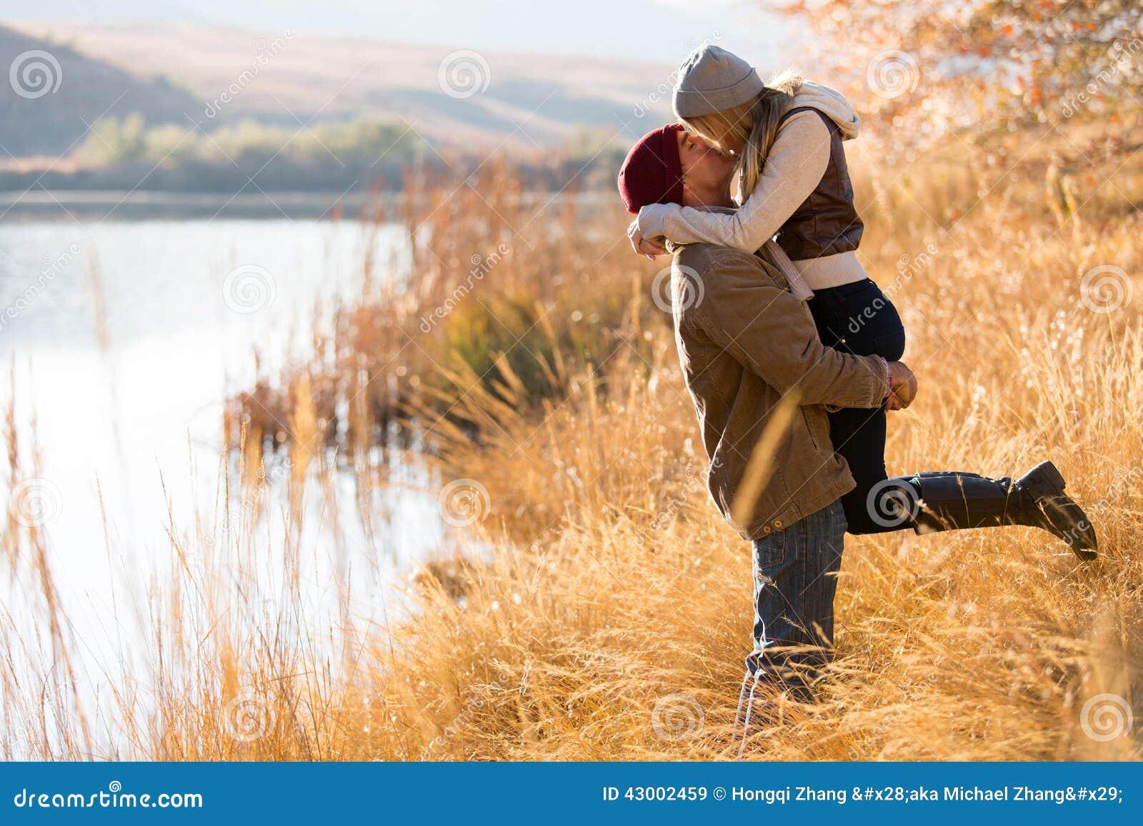 Couple kissing autumn